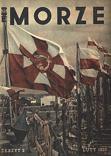 """I str. okładki miesięcznika """"Morze"""", z widokiem skrajnej dziobowej części pokładu """"Groma"""": lewą krawędź wyznacza wytyk dziobowy z podniesionym proporcem Marynarki Wojennej (biało-czerwone poziome pasy, na ich tle krzyż kawalerski w odwrotnych barwach, z ręką trzymającą kordelas wzniesiony do cięcia wpisaną w czerwone okrągłe pole na skrzyżowaniu ramion krzyża) powiewającym na wietrze. Na relingach zawieszony jest zwój liny oraz stalowa bojka (dwustożkowata), z namalowaną białą farbą literą G. W tle maszty łodzi/kutrów rybackich z flagami polskimi, stojące dziobami do nabrzeża. Na górze napis """"Morze"""" prostą czcionką, u dołu napisy """"Zeszyt 2"""" i """"Luty 1938"""" antykwą."""