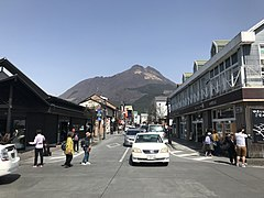 Mount Yufudake and Yufumi-dori Street in front of Yufuin Station.jpg