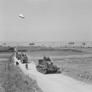 Operation Perch - Tanks from the 4th County of London Yeomanry, 7th Armoured Division, move inland from Gold Beach, 7 June 1944.