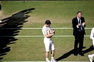 2013 Wimbledon Championships – Men's singles final - Image: Murray and the Wimbledon Trophy