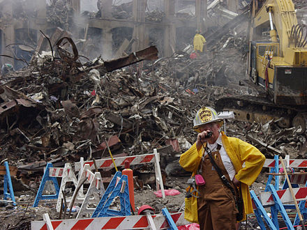 A New York City Deputy chief coordinates the recovery effort underway at the World Trade Center NY Firefighter Deputy chief at wtc.jpg