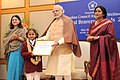 Narendra Modi presenting the National Bravery Awards 2015 to the children, in New Delhi on January 24, 2016. The Union Minister for Women and Child Development, Smt. Maneka Sanjay Gandhi is also seen.jpg