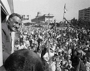El Mahalla El Kubra - President Gamal Abd El Nasser waves to crowds in El Mahalla El Kubra as he departs the city, 1959