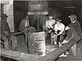 Negro laborers sitting around in front of a fire on Saturday... (3110578948).jpg
