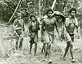New Guinea tribesmen evacuate the body of an American soldier near Buna.jpg