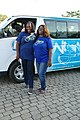 Nigerian Tourism Development Corporation - Tour guides in front of a tour bus.jpg