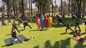 "End Love - The members of OK Go (in the bright color sweatsuits) among several extras in the ""End Love"" music video."