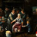 Operators letting blood from the arm of a woman in a room cr Wellcome V0017310.jpg