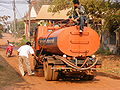 Orange water tank truck in Thailand.JPG