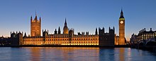 A modern photograph of the Palace of Westminster at night from across the River Thames
