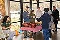 Park staff teach visitors to make buzz buttons at the 2018 Festival of Christmas Past, December 8, 2018--Warren Bielenberg (46941857492).jpg