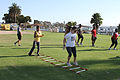 Participants of the Boot Camp Challenge training program perform slaloms during a session Aboard the Marine Corps recruit Depot San Diego CA Aug. 23, 2011 110823-M-KJ455-039.jpg