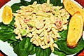 Pasta salad with spinach and garlic bread.jpg