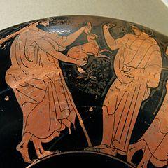 Coupe à figures rouges avec en décor Homme et jeune garçon jouant de la lyre