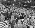 Photograph of the President and Mrs. Truman, with other dignitaries, saluting the flag at Griffith Stadium in... - NARA - 200291.jpg
