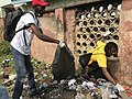 Picture of two people picking bottles during Mission Zero Plastic 02.jpg