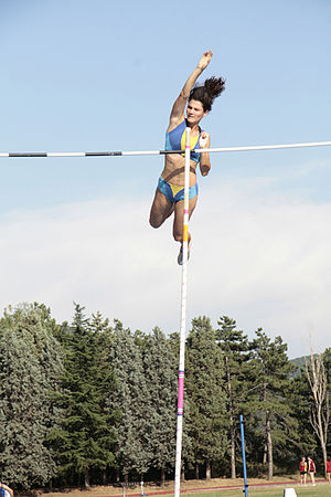 Anna Giordano Bruno releases the pole after clearing the bar - Track and field