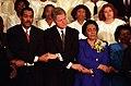 President Bill Clinton joins hands with Dexter King and Coretta Scott King.jpg