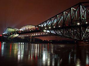 The Quebec Bridge by night, crossing the Saint...