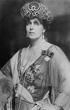 Marie of Romania - Marie wearing her regalia. Photograph by George Grantham Bain.