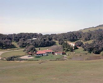 "Rancho del Cielo - Rancho del Cielo – the adobe house (center) that belonged to President and Mrs. Reagan, ""Lake Lucky"" (right), and the barn (center, partially hidden) for the horses."