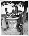 Ranger Larry Quist & visitor toast each other with cups of hot water from Noble Fountain (3213ab16-0974-441f-92cc-46c79d6d9d1a).jpg