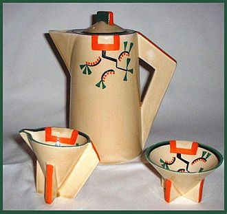 Clarice Cliff - Clarice's 'Ravel' pattern on conical shape coffee pot, sugar and cream – 1930.