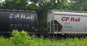 Reporting mark - Reporting marks on two CP covered hopper cars; with the left car marked as CP 388686 and the right car marked as SOO 115239