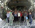 Rescued persons from quake-hit Nepal are de-boarding from an IAF transport aircraft, at Palam airport, in New Delhi.jpg