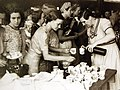 Residents of Penang at Ipoh Station, Perak having refreshments from local residents, WWII (23916855204).jpg