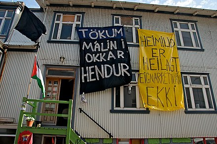 "A short-lived squat in Reykjavik in 2009. The signs say ""We take matters into our own hands"" and ""The home is not sacred property"" Reykjavik Squat, Iceland (3446319888).jpg"