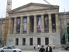 The National Portrait Gallery shares the Reynolds Center with the Smithsonian American Art Museum. A construction crane used to build the new Kogod Courtyard is visible.