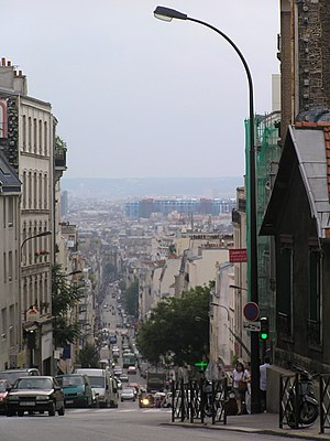 Ménilmontant - Rue de Ménilmontant, the main street of Ménilmontant, with central Paris and the Centre Georges Pompidou in the distance
