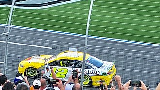 2018 Bank of America Roval 400 - Ryan Blaney drives to the finish line in the opposite direction after winning the 2018 Bank of America 400.