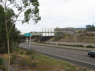 California State Route 56 - SR 56 east at Carmel Creek Road; the exits on the sign were constructed with the missing portion of the freeway that was completed in 2004.