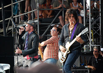 2008 Stone Temple Pilots Reunion Tour - STP (from l-r: Scott Weiland, Robert DeLeo, and Dean DeLeo) playing at the Virgin Mobile Festival in Baltimore on August 10