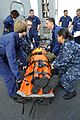 Sailors carry a simulated patient. (8408580406).jpg