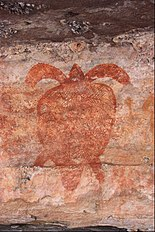 Painting of marine turtle on a rock wall in Australia