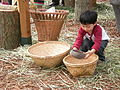 Seattle Pagdiriwang - child playing with rice.jpg