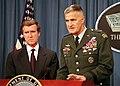 Secretary Cohen listens as Gen. Shelton briefs reporters in the Pentagon on Sudan and Afghanistan.jpg