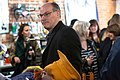 Senator Amy Klobuchar's husband, John Bessler holds his wife's coat at a campaign event in Eau Claire, Wisconsin.jpg