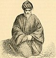 Sheikh praying in a sitting posture.jpg