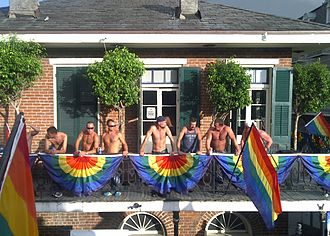 Southern Decadence - Shirtless men on a Bourbon Street balcony during Southern Decadence.