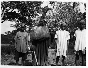 "Poro - A ""falui"" masker, a one-armed warrior spirit. Panguma, Sierra Leone."