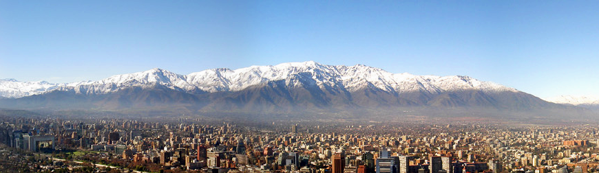 Panoramic view of northeastern Santiago, as seen from the hills of Parque Metropolitano in Providencia. Visible in the background are Apoquindo and Sierra de Ramón.