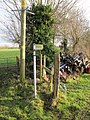 Sign by the stile - geograph.org.uk - 1638075.jpg
