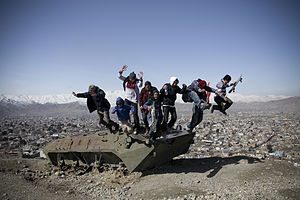 Skateistan: To Live and Skate Kabul - Skateistan pupils and staff jump from a discarded tank on Wazir Akbar Khan hill overlooking Kabul. Photo Jacob Simkin