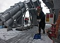 Sonar Technician shoveling snow on deck of USS Benfold (DDG-65) near Harpoon launcher 160207-N-EM227-652.jpg