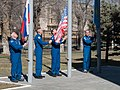 Soyuz MS-04 crew members with their backups raise flags.jpg