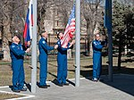Soyuz MS-04 crew members with their backups raise flags.jpg